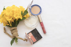Beauty skin face set cosmetics makeup. Background accessories beauty skin face cosmetics makeup and bouquet flowers royalty free stock photography