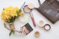 Beauty skin face set cosmetics makeup. Background accessories beauty skin face cosmetics makeup and bouquet flowers stock photography