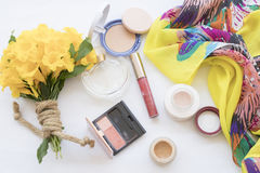 Beauty skin face set cosmetics makeup on concept yellow mellow. Background accessories beauty skin face cosmetics makeup and bouquet flowers royalty free stock photos