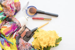 Beauty skin face set cosmetics makeup on concept yellow mellow. Background accessories beauty skin face cosmetics makeup and bouquet flowers stock photography