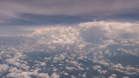 Beauty sky and big clouds in natural sky look from the plane window Royalty Free Stock Photo