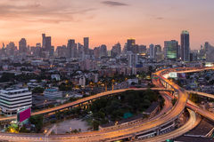 Beauty of sky after sunset over intersection highway with city downtown background Stock Image