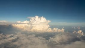 Beauty sky and super big the sunshines clouds in nature. Look from the plane window Royalty Free Stock Images