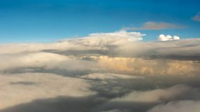 Beauty sky and super big the sunshines clouds in nature. Look from the plane window Royalty Free Stock Image