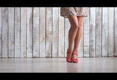 Beauty slim legs. Slim beauty legs in shoes on floor Royalty Free Stock Photos