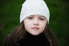 Beauty small girl with blue eyes in white hat Stock Photo