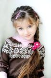 Beauty small girl with long dark braid Royalty Free Stock Photos