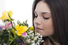 Beauty smelling flowers Stock Photos