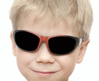 Beauty smiling child boy in sunglasses Stock Photo