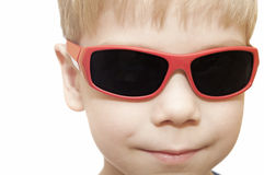 Beauty smiling child boy in sunglasses Stock Photos