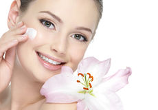 Beauty smiling girl with cream on face stock photo