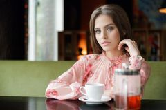 Beauty smiling happy model with natural make up and long eyelashes smiles in cafe royalty free stock image
