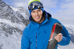 Beauty smiling man in winter Stock Images