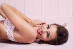 Beauty smiling pinup girl lying Stock Photography