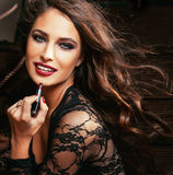 Beauty smiling rich woman in lace with dark red lipstick. Flying hair close up stock images