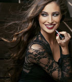 Beauty smiling rich woman in lace with dark red lipstick, flying hair close up Stock Photo