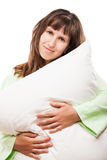 Beauty smiling woman holding pillow for rest and sleep Stock Photography