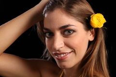 Beauty smiling with yellow rose flower in hair Stock Photography