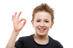 Beauty smiling young teenager boy gesturing OK or success sign Royalty Free Stock Images