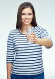 Beauty smiling young woman holding water glass. Portrait isolated on white background Stock Photos