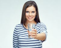 Beauty smiling young woman holding water glass. Portrait  on white background Royalty Free Stock Images