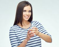 Beauty smiling young woman holding water glass. Royalty Free Stock Image