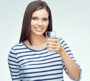 Beauty smiling young woman holding water glass. Stock Photo