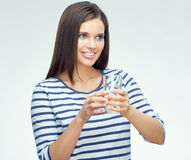 Beauty smiling young woman holding water glass. Portrait isolated on white background Stock Photo