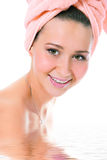 Beauty smiling young woman in towel Stock Images