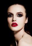 Beauty smokey eyes red lips makeup fashion model Royalty Free Stock Photos