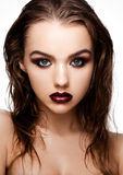 Beauty smokey eyes red lips makeup wet hair model. On grey background stock images