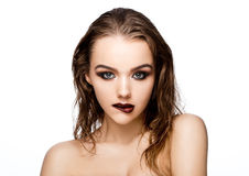 Beauty smokey eyes red lips makeup wet hair model. On grey background stock photo