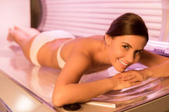 Beauty in solarium. Stock Photos