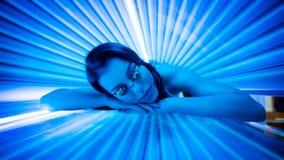 Beauty in solarium. Royalty Free Stock Photo