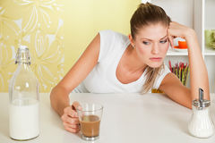 Beauty, sorrowful girl with a cup of coffee Stock Photo