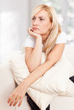 Beauty, sorrowful woman on a sofa Stock Image