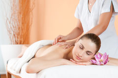 Beauty spa. Beautiful young girl relaxing with hand massage at spa during a beauty treatment Stock Images