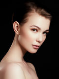 Beauty, spa. Attractive woman with beautiful face. Beautiful girl with daily makeup, youth and skin care concept. Woman beauty face portrait isolated on black royalty free stock photo
