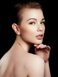 Beauty, spa. Attractive woman with beautiful face. Beautiful girl with daily makeup, youth and skin care concept. Woman beauty face portrait isolated on black Stock Images
