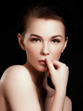 Beauty, spa. Attractive woman with beautiful face. Beautiful girl with daily makeup, youth and skin care concept. Woman beauty face portrait isolated on black Stock Photo