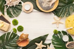 Spa background with facial mask and cream on white wood. Beauty spa background, top view. Various cosmetic products on white wood. Sea salt, natural olive soap Royalty Free Stock Photos