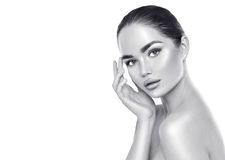 Beauty spa brunette woman touching her face. Skincare. Concept. Black and white portrait stock image