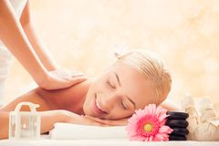 Woman in spa salon getting massage royalty free stock photography