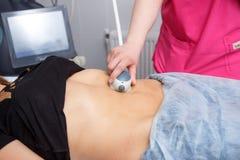 Beauty Spa die, Menselijke Hand, de Medische Laser van Liposuction, de Groei, Toekomst, Zorg, Bescherming op dieet zijn royalty-vrije stock foto
