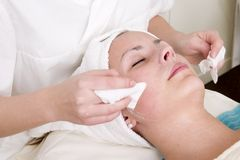 Beauty Spa Facial. Lotion being wiped off during a facial at a beauty spa Stock Image