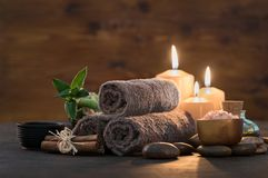 Beauty spa treatment with candles stock images