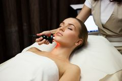 Beauty spa treatment. Woman lies on a table in a beauty spa getting a treatment Royalty Free Stock Photos