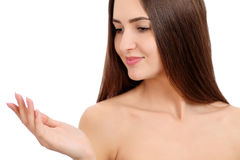 Beauty Spa Woman with perfect skin Portrait. Beautiful Brunette Spa Girl showing empty copy space on the open hand palm Royalty Free Stock Image