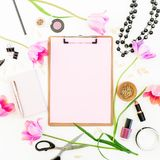 Beauty space with clipboard, notebook, cosmetics, flowers and accessories on white background. Flat lay, top view. Beauty space with clipboard, notebook stock photos