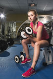 Beauty sporty woman in gym Stock Photography